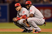Eugenio Suarez and Brandon Phillips of the Cincinnati Reds talk during a pitching change during the game against the San Diego Padres during the game...