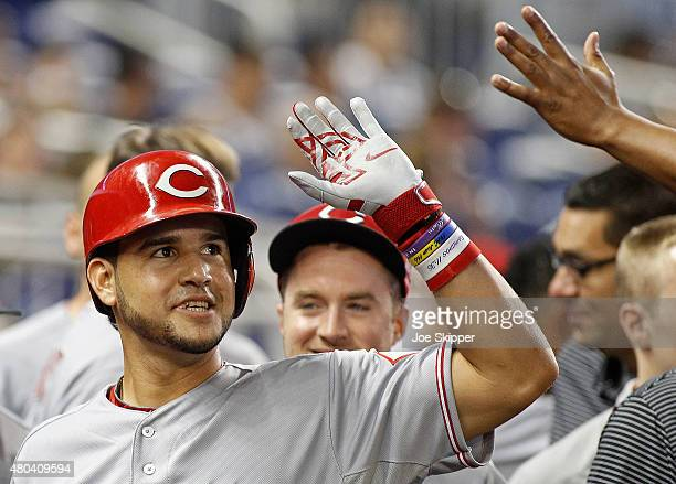 Eugenio Suarez left of the Cincinnati Reds celebrates with teammates after hitting a solo home run in the second inning of play against the Miami...