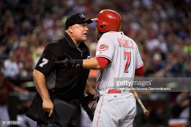 Eugenio Suarez of the Cincinnati Reds argues with home plate umpire Brian O'Nora after being ejected during a game against the Arizona Diamondbacks...
