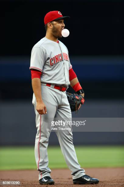 Eugenio Suarez of the Cincinnati Reds blows a bubble while standing at third base during the game against the New York Yankees at Yankee Stadium on...