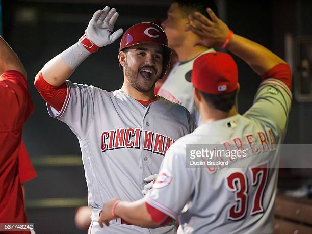 Eugenio Suarez of the Cincinnati Reds celebrates after hitting a solo home run for his second of the game against the Colorado Rockies in the sixth...