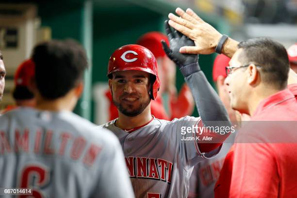 Eugenio Suarez of the Cincinnati Reds celebrates at the dugout after hitting a home run in the fifth inning against the Pittsburgh Pirates at PNC...