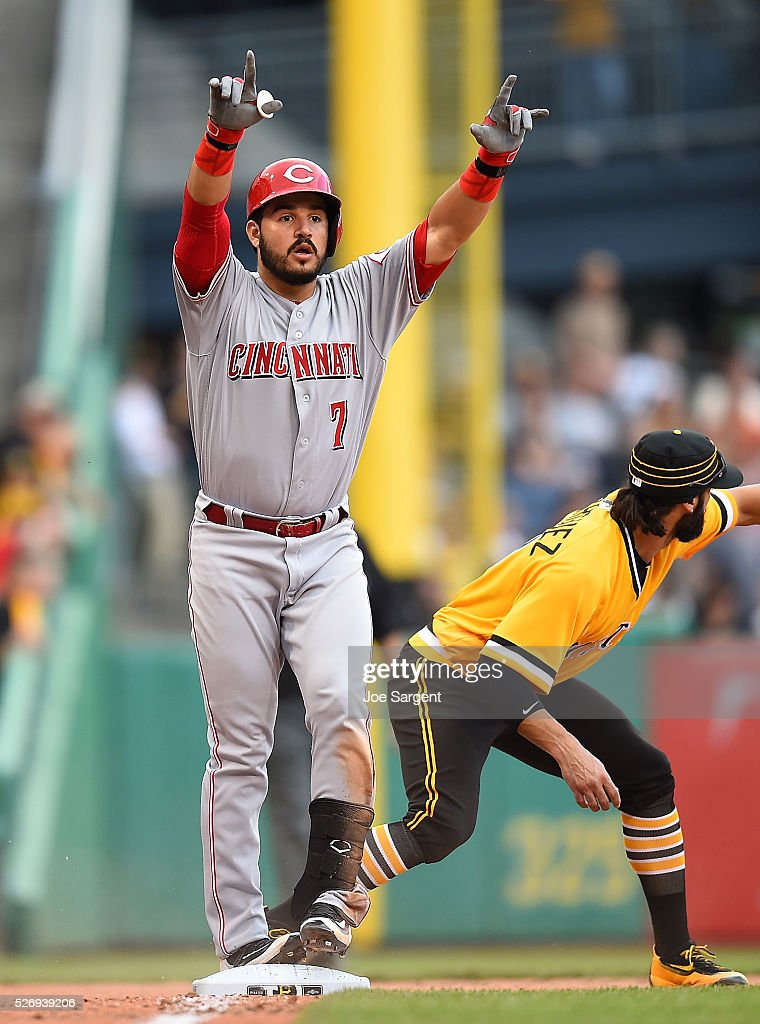 Eugenio Suarez #7 of the Cincinnati Reds celebrates in front of Sean Rodriguez #3 of the Pittsburgh Pirates after hitting a triple during the eleventh inning on May 1, 2016 at PNC Park in Pittsburgh, Pennsylvania.