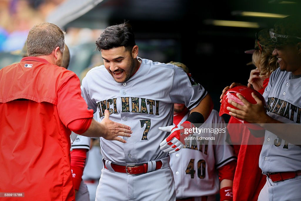 <a gi-track='captionPersonalityLinkClicked' href=/galleries/search?phrase=Eugenio+Suarez&family=editorial&specificpeople=10488763 ng-click='$event.stopPropagation()'>Eugenio Suarez</a> #7 of the Cincinnati Reds celebrates in the dugout after hitting a solo home run during the seventh inning against the Colorado Rockies at Coors Field on May 30, 2016 in Denver, Colorado.