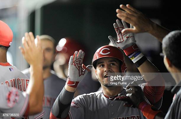 Eugenio Suarez of the Cincinnati Reds celebrates with teammates after hitting the game winning home run in the eighth inning against the Washington...