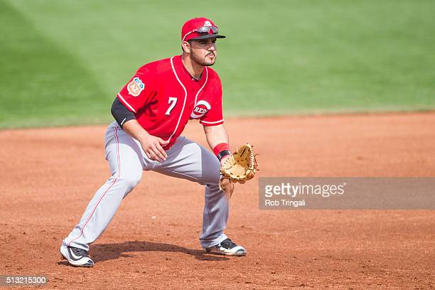 Eugenio Suarez of the Cincinnati Reds fields his position during a spring training game against the Cleveland Indians at Goodyear Ballpark on March 1...