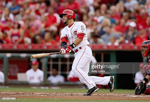 Eugenio Suarez of the Cincinnati Reds hits a run scoring single in the first inning against the St Louis Cardinals at Great American Ball Park on...