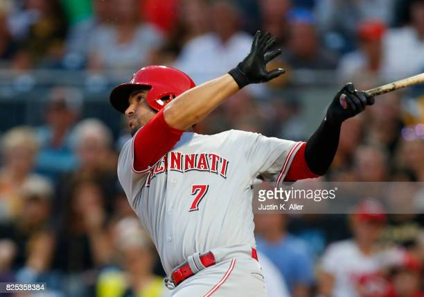 Eugenio Suarez of the Cincinnati Reds hits a sacrifice fly in the third inning against the Pittsburgh Pirates at PNC Park on August 1 2017 in...