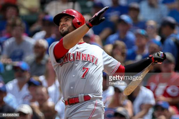 Eugenio Suarez of the Cincinnati Reds hits a single in the second inning against the Chicago Cubs at Wrigley Field on August 17 2017 in Chicago...