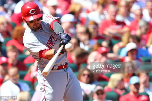 Eugenio Suarez of the Cincinnati Reds hits an RBI double against the Cincinnati Reds in the fourth inning at Busch Stadium on April 8 2017 in St...