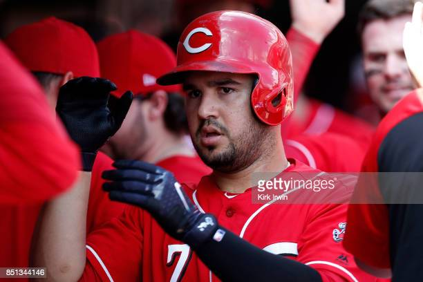 Eugenio Suarez of the Cincinnati Reds is congratulated after hitting a home run during the game against the Pittsburgh Pirates at Great American Ball...