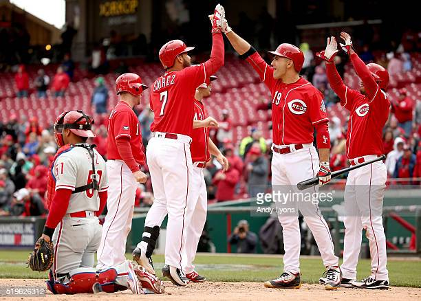 Eugenio Suarez of the Cincinnati Reds is congratulated by Joey Votto after hitting a grand slam home run in the 4th inning during the game against...