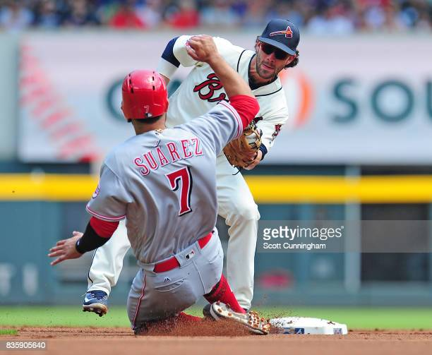Eugenio Suarez of the Cincinnati Reds is tagged out on a second inning steal attempt by Dansby Swanson of the Atlanta Braves at SunTrust Park on...