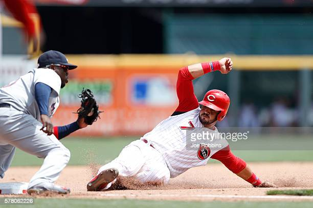 Eugenio Suarez of the Cincinnati Reds is thrown out trying to steal third base in the seventh inning against the Atlanta Braves at Great American...