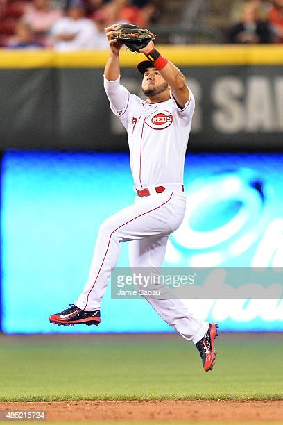 Eugenio Suarez of the Cincinnati Reds leaps up to snag a line drive off the bat of Yasiel Puig of the Los Angeles Dodgers to end the sixth inning at...