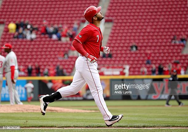 Eugenio Suarez of the Cincinnati Reds looks upward as he runs the bases after hitting a grand slam home run in the 4th inning during the game against...