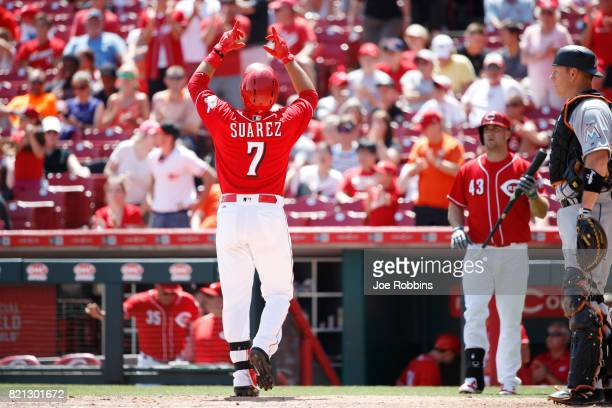 Eugenio Suarez of the Cincinnati Reds reacts after a solo home run in the sixth inning of a game against the Miami Marlins at Great American Ball...