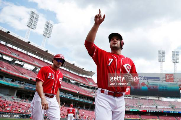 Eugenio Suarez of the Cincinnati Reds reacts after scoring a run following a throwing error by Hernan Perez of the Milwaukee Brewers in the third...
