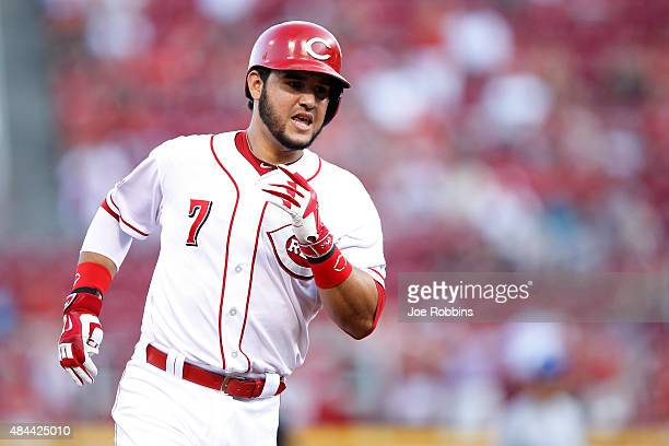 Eugenio Suarez of the Cincinnati Reds rounds the bases after hitting a solo home run in the first inning against the Kansas City Royals at Great...