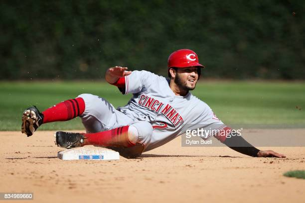 Eugenio Suarez of the Cincinnati Reds steals second base in the eighth inning against the Chicago Cubs at Wrigley Field on August 17 2017 in Chicago...