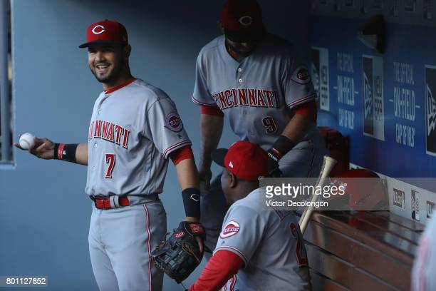 Eugenio Suarez of the Cincinnati Reds talks with teammates in the dugout prior to the MLB game against the Los Angeles Dodgers at Dodger Stadium on...