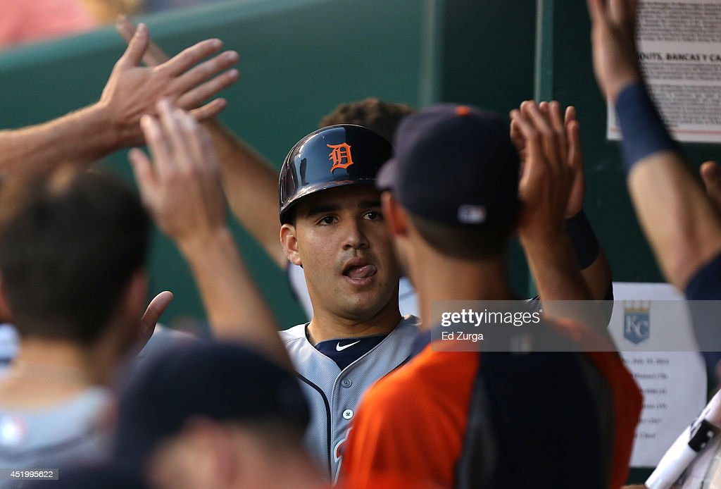 <a gi-track='captionPersonalityLinkClicked' href=/galleries/search?phrase=Eugenio+Suarez&family=editorial&specificpeople=10488763 ng-click='$event.stopPropagation()'>Eugenio Suarez</a> #30 of the Detroit Tigers celebrates after scoring on an Ian Kinsler sacrifice fly in the fourth inning at Kauffman Stadium on July 10, 2014 at Kauffman Stadium in Kansas City, Missouri.
