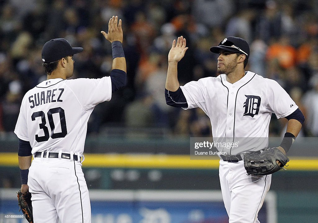 <a gi-track='captionPersonalityLinkClicked' href=/galleries/search?phrase=Eugenio+Suarez&family=editorial&specificpeople=10488763 ng-click='$event.stopPropagation()'>Eugenio Suarez</a> #30 of the Detroit Tigers gets a high-five from <a gi-track='captionPersonalityLinkClicked' href=/galleries/search?phrase=J.D.+Martinez&family=editorial&specificpeople=7520024 ng-click='$event.stopPropagation()'>J.D. Martinez</a> #28 of the Detroit Tigers after a 8-1 win over the Tampa Bay Rays at Comerica Park on July 3, 2014 in Detroit, Michigan.