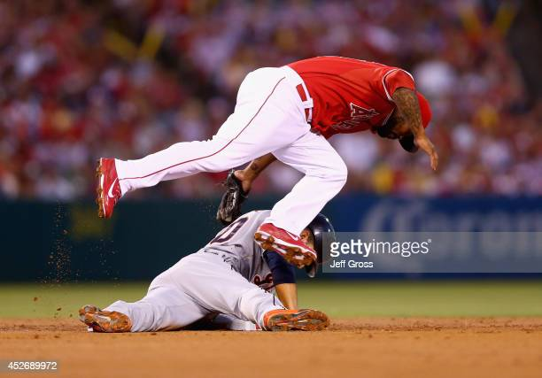 Eugenio Suarez of the Detroit Tigers is tagged out by second baseman Howie Kendrick of the Los Angeles Angels of Anaheim during a steal attempt in...