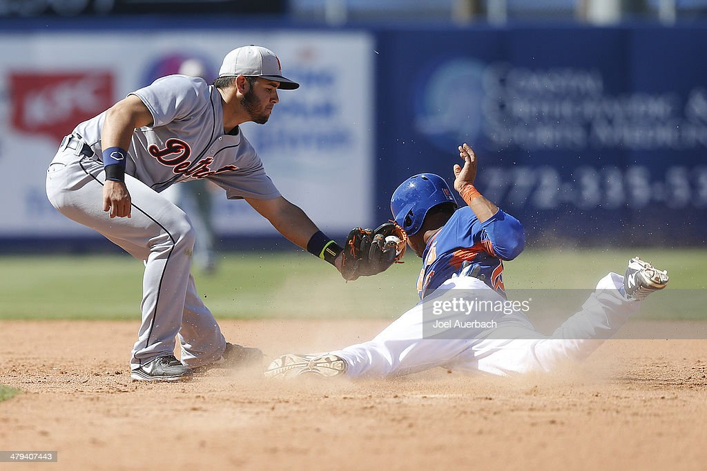 Eugenio Suarez #27 of the Detroit Tigers tags Juan Lagares #12 of the New York Mets out attempting to steal to end the eighth inning during a spring training game at Tradition Field on March 18, 2014 in Port St. Lucie, Florida. The Mets defeated the Tigers 5-4.