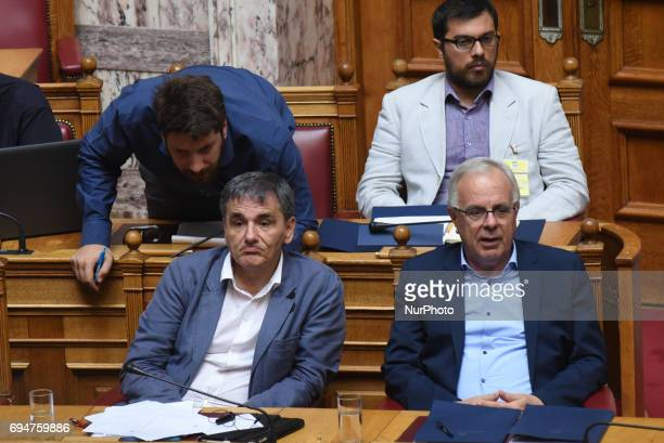 Euklid Tsakalotos Minister of Finance Vangelis Apostolou Minister of Agriculture during discussion in the hellenic parliament on a draft law for...