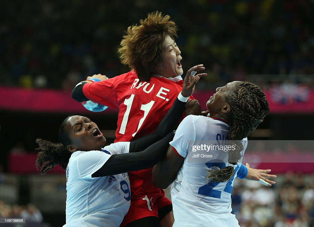 Eun Hee Ryu #11 of Korea is defended by <a gi-track='captionPersonalityLinkClicked' href=/galleries/search?phrase=Paule+Baudouin&family=editorial&specificpeople=2650216 ng-click='$event.stopPropagation()'>Paule Baudouin</a> (L) #9 and <a gi-track='captionPersonalityLinkClicked' href=/galleries/search?phrase=Mariama+Signate&family=editorial&specificpeople=2206555 ng-click='$event.stopPropagation()'>Mariama Signate</a> (R) #24 of France during the Women's Handball Preliminaries Group B match between Korea and France on Day 7 of the London 2012 Olympic Games at Copper Box on August 3, 2012 in London, England.
