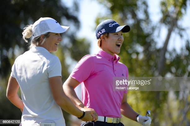 Eun Jeong Seong of South Korea celebrates a hole in one with Mel Reid of England on the fifth hole during round one of the ANA Inspiration on the...