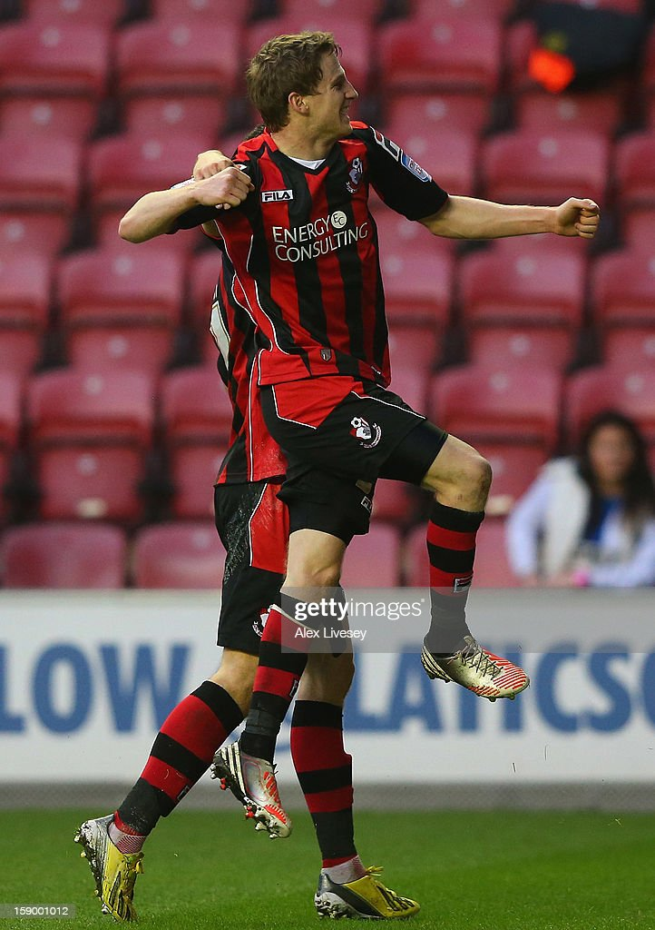 Eunan O'Kane of AFC Bournemouth celebrates after scoring the opening goal during the Budweiser FA Cup Third Round match between Wigan Athletic and AFC Bournemouth at DW Stadium on January 5, 2013 in Wigan, England.