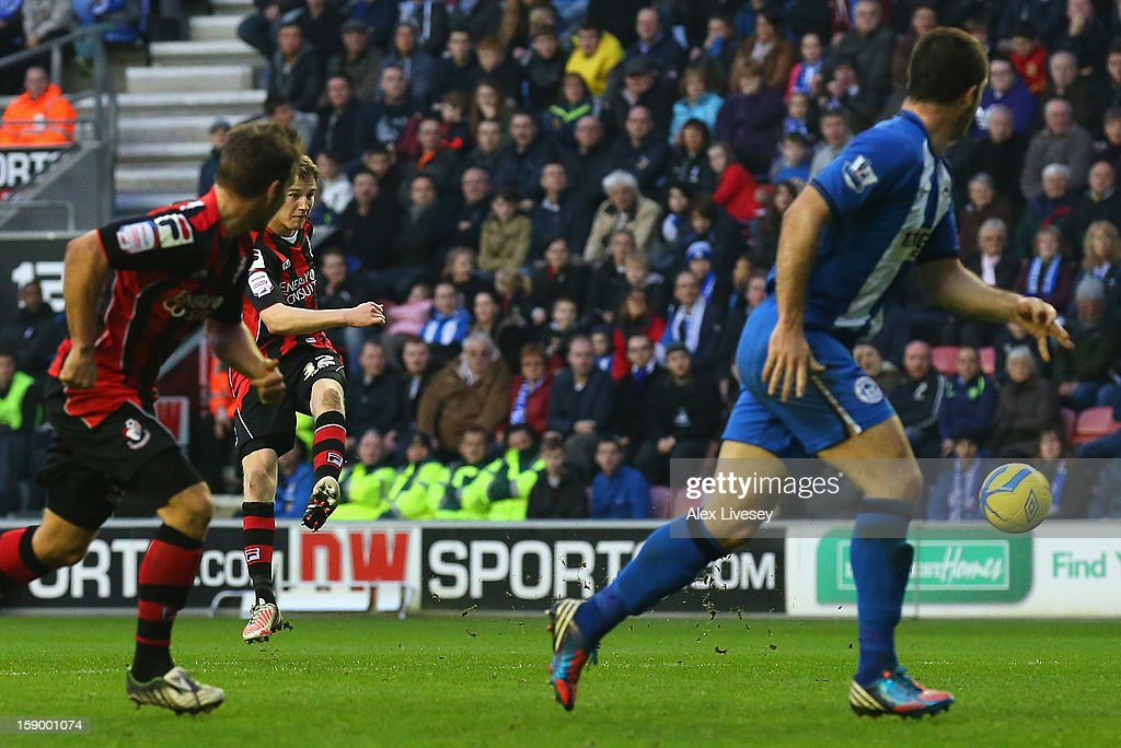 Eunan O'Kane of AFC Bournemouth scores the opening goal during the Budweiser FA Cup Third Round match between Wigan Athletic and AFC Bournemouth at DW Stadium on January 5, 2013 in Wigan, England.