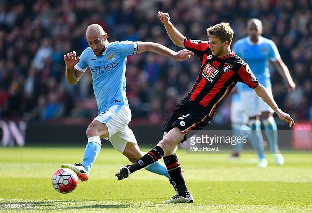Eunan O'Kane of Bournemouth and Pablo Zabaleta of Manchester City compete for the ball during the Barclays Premier League match between AFC...