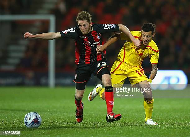Eunan O'Kane of Bournemouth challenges for the ball with Philippe Coutinho of Liverpool during the Capital One Cup QuarterFinal match between...