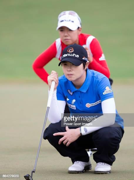EunHee Ji of South Korea and Jenny Shin of South Korea line up a putt on the 6th hole during day three of the Swinging Skirts LPGA Taiwan...