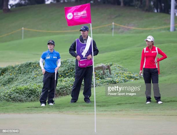 EunHee Ji of South Korea and Jenny Shin of South Korea wait to putt on the 18th hole during day three of the Swinging Skirts LPGA Taiwan Championship...