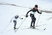 EunHo Kim of Korea and Andrew Pohl of New Zealand compete in the FIS CrossCountry Skiing ANC Mass Start Classic Mens race during the Winter Games NZ...