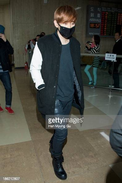Eunhyuk of boy band Super Junior M is seen upon arrival at the Gimpo Airport on October 28 2013 in Seoul South Korea