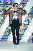 Eunhyuk of South Korean boy band Super Junior attends the store opening for 'Adidas Originals' flagship store on July 31 2014 in Seoul South Korea