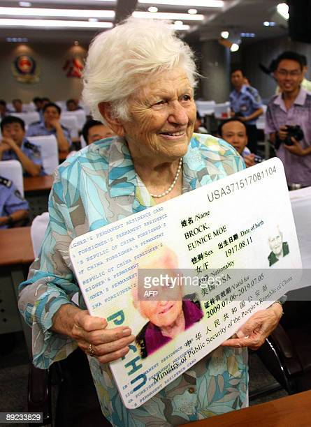 Eunice Moe Brock from the US shows off her Chinese permanent resident card or 'Green Card' during a ceremony in Liancheng in northeast China's...