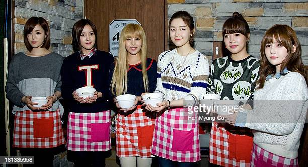 Eunjung Hyomin Qri Areum Soyeon and Boram of South Korean girl group Tara pose for media as hold tteokguk at the Core Contents Media Artists New...