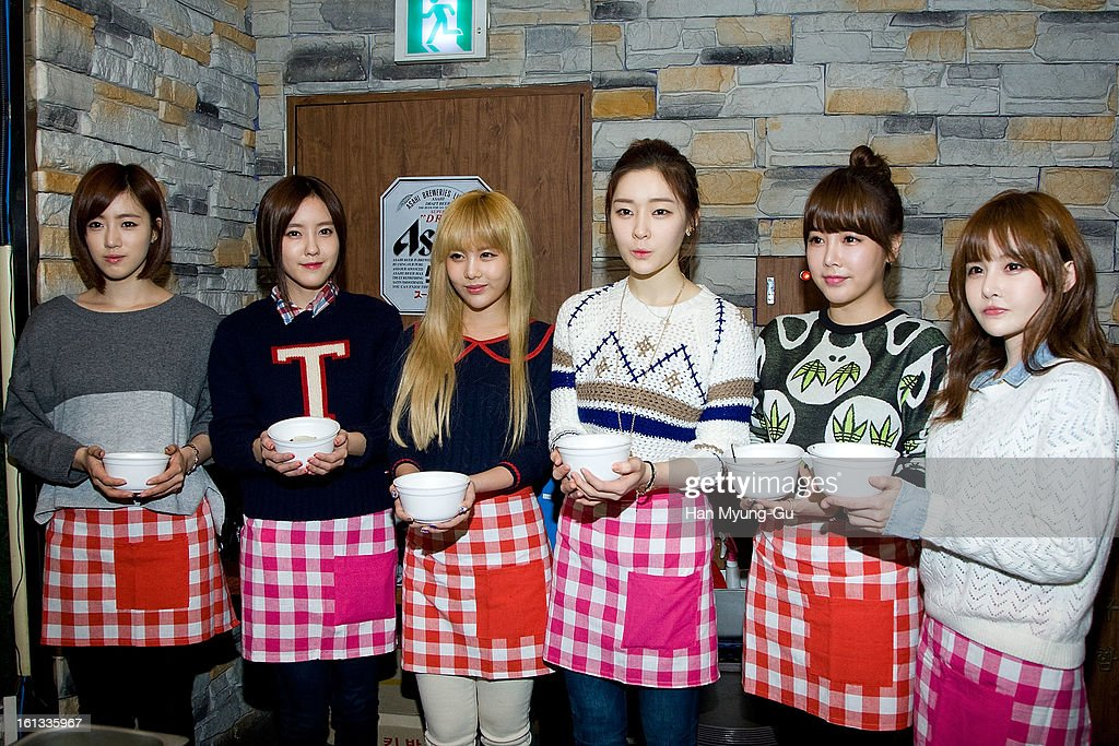Eunjung (Eun-Jung), Hyomin (Hyo-Min), Qri, Areum, Soyeon (So-Yeon) and Boram of South Korean girl group T-ara pose for media as hold tteokguk (rice-cake soup) at the Core Contents Media Artists New Year's Day Charity Event at Gibalhan Chicken Store on February 9, 2013 in Bucheon, South Korea.