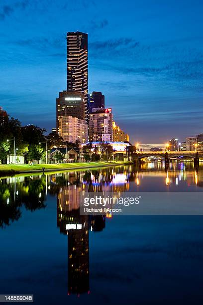Eureka Tower and Southbank hi-rise buildings reflected in Yarra River.