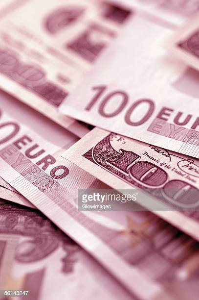 'Euro 100 bank notes and United States one hundred dollar bills, close-up'