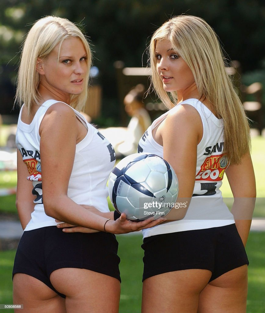 Euro 2004 AntiViolence Squad team members Laura and Naomi K pose in their uniforms before heading to Portugal on June 11 2004 in Soho Square London...