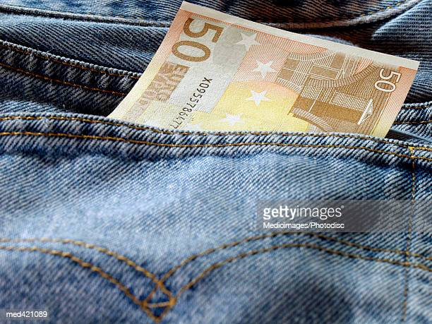 Euro bank note in a person's back jeans pocket