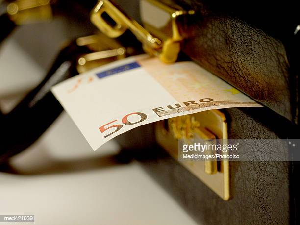 Euro bank note sticking out of a briefcase