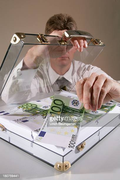 Euro bank notes in a glassy suitcase